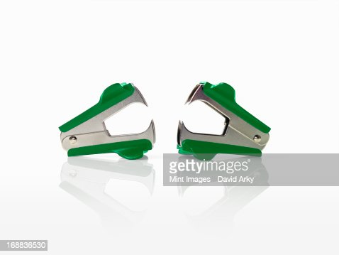 Two green staple removers with pincers.