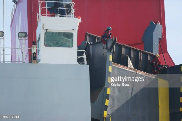 Two Greenpeace climbers scale the back of the cargo ship to prepare to deploy a banner calling for VW to ditch dieselSeptember 21st 2017 Thames...