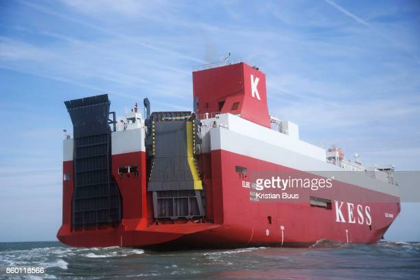 Two Greenpeace climbers scale the back of the cargo ship to prepare to deploy a banner calling for VW to ditch diesel September 21st 2017 Thames...