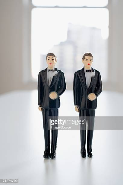 Two groom wedding cake figurines