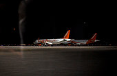 Two grounded EasyJet aircraft sit on the tarmac on November 05 2015 in Sharm ElSheikh Egypt British airplanes going in and out of the Egyptian resort...