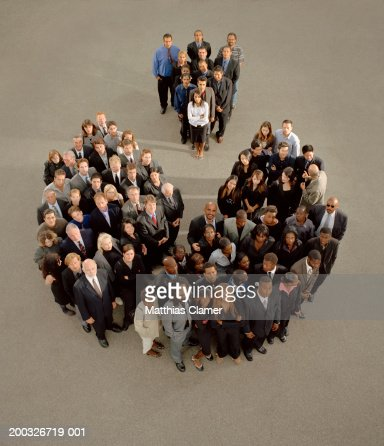 Two groups of people in plaza looking upwards, elevated view : Stock Photo