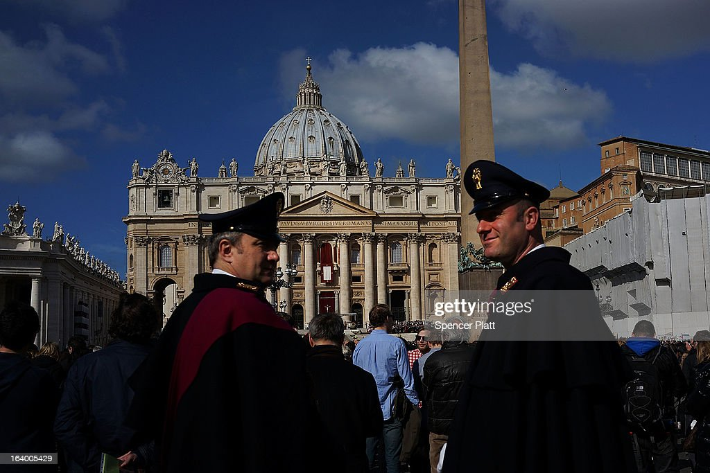 Two guards keep watch during the Inauguration Mass for Pope Francis in St Peter's Square on March 19, 2013 in Vatican City, Vatican. The mass is being held in front of an expected crowd of up to one million pilgrims and faithful who have filled the square and the surrounding streets to see the former Cardinal of Buenos Aires officially take up his role as pontiff.