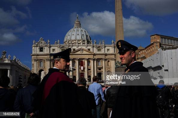 Two guards keep watch during the Inauguration Mass for Pope Francis in St Peter's Square on March 19 2013 in Vatican City Vatican The mass is being...