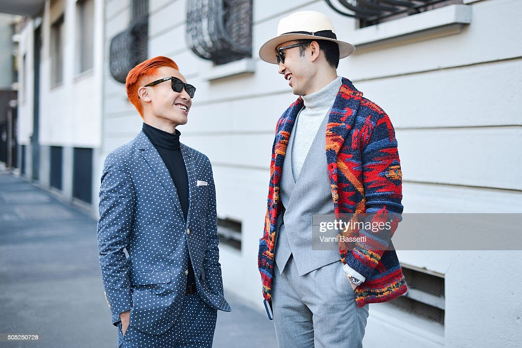 Two guests pose after the Marni show during the Milan Men's Fashion Week Fall/Winter 2016/17 on January 16, 2016 in Milan, Italy.