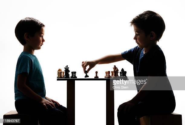 Two Half Asian Brothers playing chess