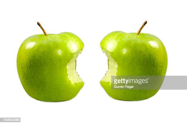 Two half-eaten apples Granny Smith
