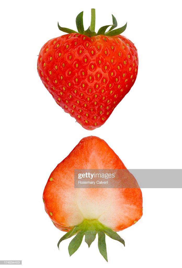 Two halves of fresh, ripe strawberry