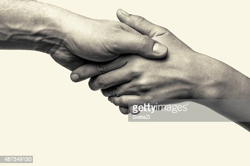 Two hands - help : Stock Photo