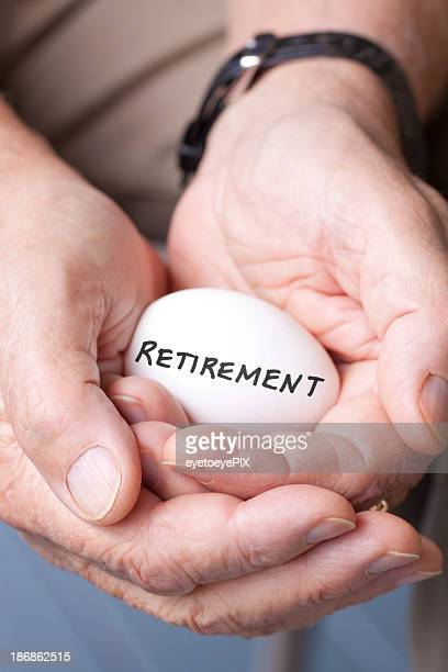 Two hands holding an egg with retirement written on it
