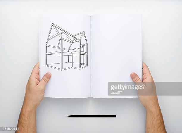 Deux mains tenant la vierge de Magazine ouvert