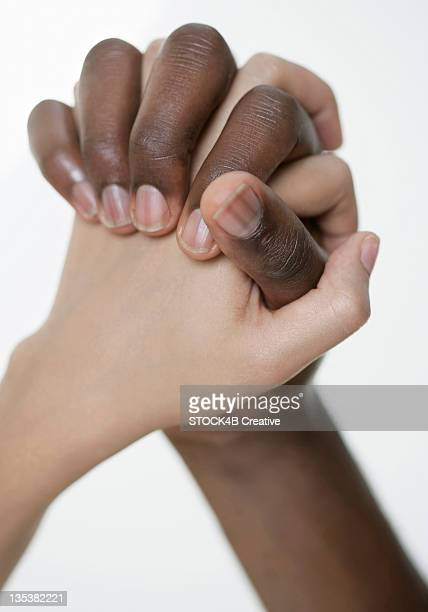 Two hands intertwined