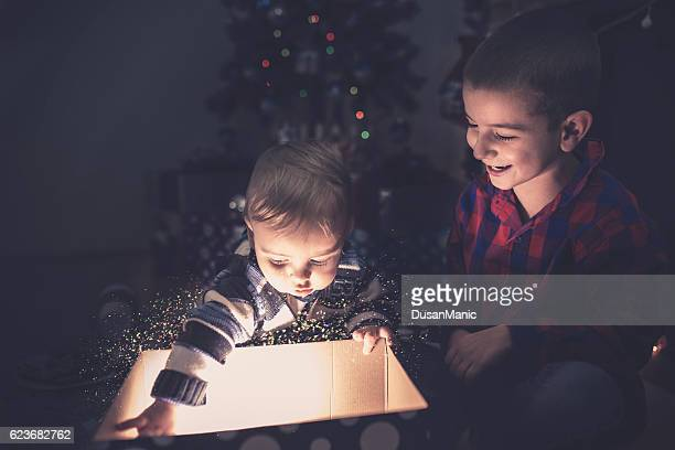 two happy boy open christmas gift-box