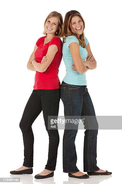 Two happy female friends standing together