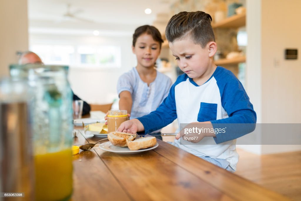 Two happy kids having healthy breakfast. : Stock Photo