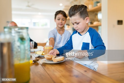 Two happy kids having healthy breakfast. : Foto stock
