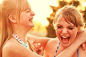 Two Happy Laughing Girls Water Fight Fun