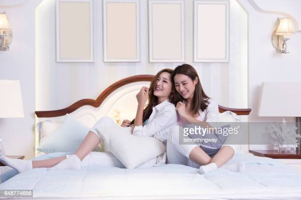 Two happy woman friends in living room