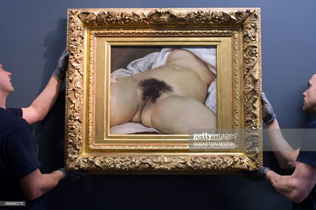 Two hauliers install the Gustave Courbet's canvas 'L'origine du monde' at the Courbet museum on June 3 in Ornans eastern France The canvas will be...