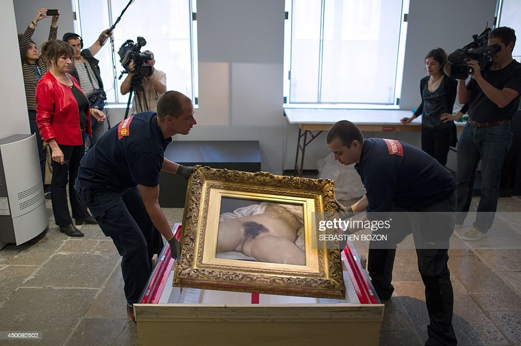 Two hauliers prepare to install the Gustave Courbet's canvas 'L'origine du monde' at the Courbet museum on June 3 in Ornans eastern France The canvas...