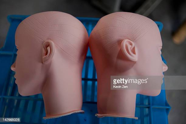 Two heads of unfinished sex dolls are stored at the Jiamei Plastic Toy Factory on February 18 2012 in Ningbo China The Jiamei plastic toy company...
