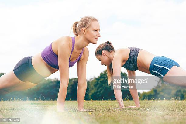 Two healthy females planking