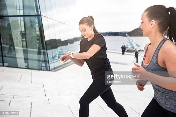 Two healthy women ready to start workout in town