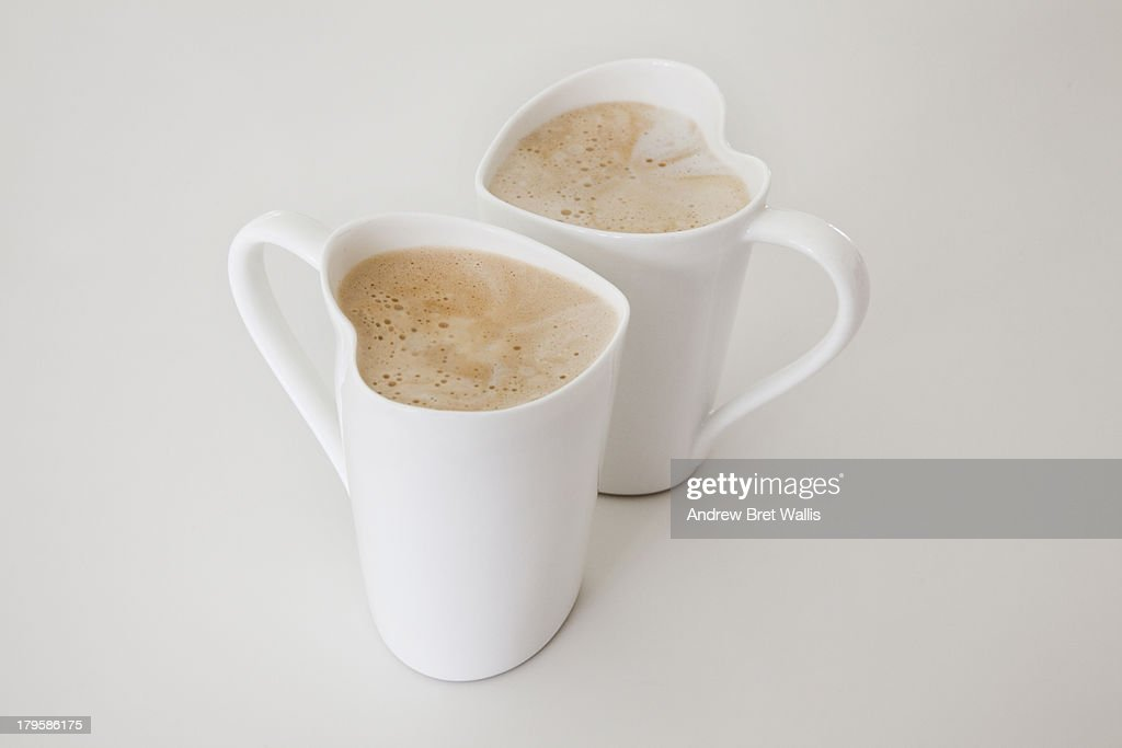 Two Heart Shaped Cups Filled With Coffee Latte Stock Photo