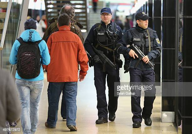 Two heavilyarmed German policemen patrol through a shopping passage inside Hauptbahnhof main railway station the day after the Germany vs Netherlands...