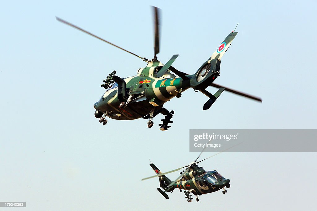 Two helicopters perform during the 2nd China Helicopter Exhibition on September 1, 2013 in Tianjin, China. The 2nd China Helicopter Exhibition will be held from September 5 to 8.