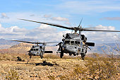 Two HH-60 Pavehawk helicopters land during a personnel recovery training exercise/Angel Thunder 2008. Over 250 ground recovery personnel took part in Angel Thunder '08.