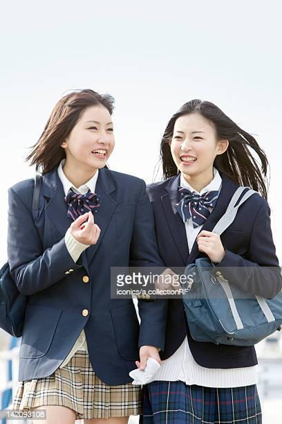 Two high school girls walking