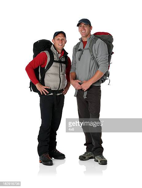 Two hikers carrying backpacks and smiling
