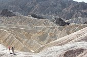 Two hikers in desert (high angle view), Death Valley, California, USA