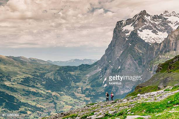 Two hikers on Eiger Trail, Switzerland