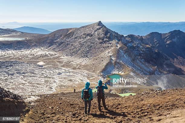 Two hikers taking a photo, Tongariro crossing