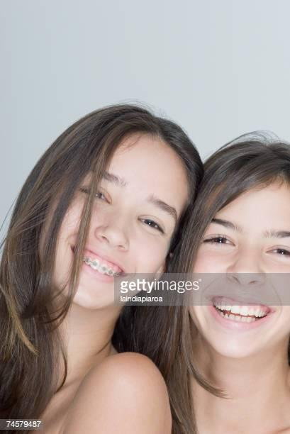 Two Hispanic teenage girls smiling