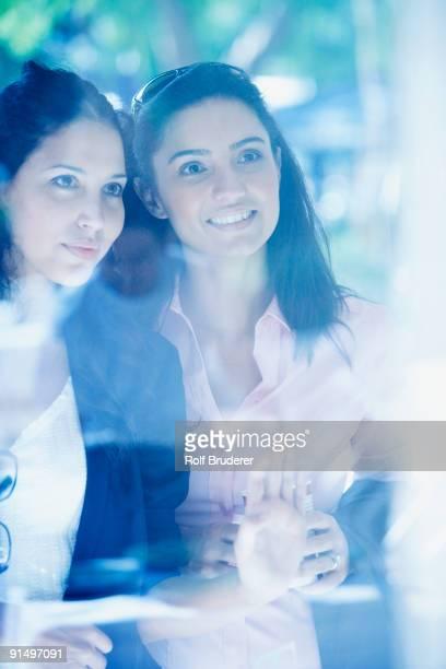 Two Hispanic woman window shopping