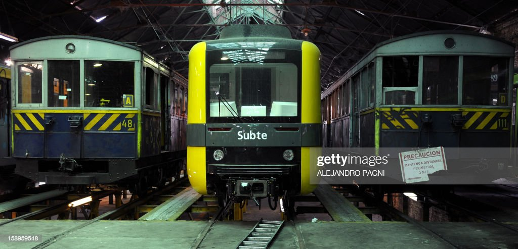Two historic wagons of La Brugeoise and one of the new Chinese train (C) remain parked at the garage El Polvorin, in the neighborhood of Caballito, Buenos Aires on January 4, 2013. The Line A will be closed betwen January 12 and March 8 following a decision by Buenos Aires city Mayor Mauricio Macri to replace the fleet with Chinese-made wagons. Line A was the first subway line to work in the southern hemisphere and its trains are among the ten oldest still working daily. The La Brugeoise wagons were constructed between 1912 and 1919 by La Brugeoise et Nicaise et Delcuve in Belgium.
