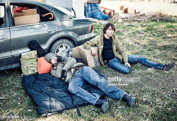 Two Homeless Men Living Out of a Car