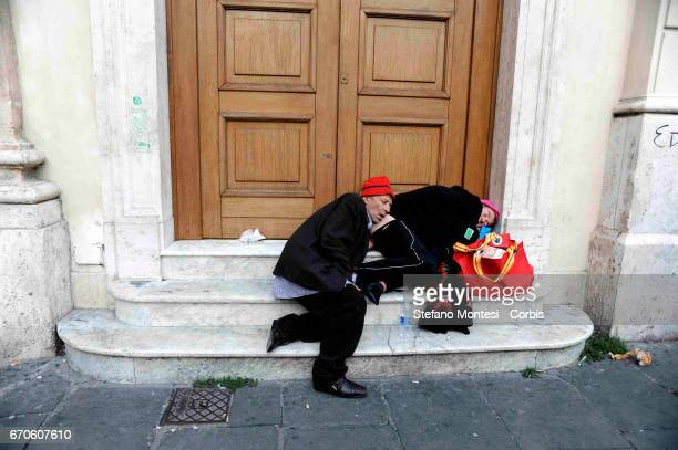 Two homeless people sleep on the steps of the post office building in Piazza San Silvestro on November 6 2008 in Rome Italy