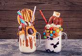 Two homemade extreme milkshakes jars on table