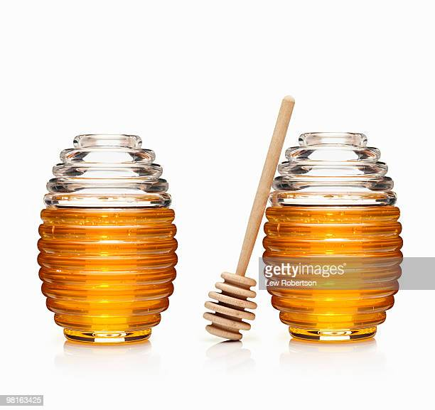 Two Honey Jars with dipper