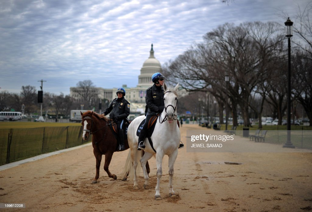 Two horse-mounted park policewomen patrol along the Mall as preparations continue for the second inauguration of US President Barack Obama in Washington, DC, on January 17, 2013. Obama faces a near impossible task in his second inaugural address on January 21, uniting a nation in which the compromise that oils governing is crushed by deep political divides. Before a crowd of thousands and the eyes of the world on television and online, Obama will stand on the West Front of the US Capitol and swear to faithfully execute the office of president and defend the Constitution. AFP PHOTO/Jewel Samad