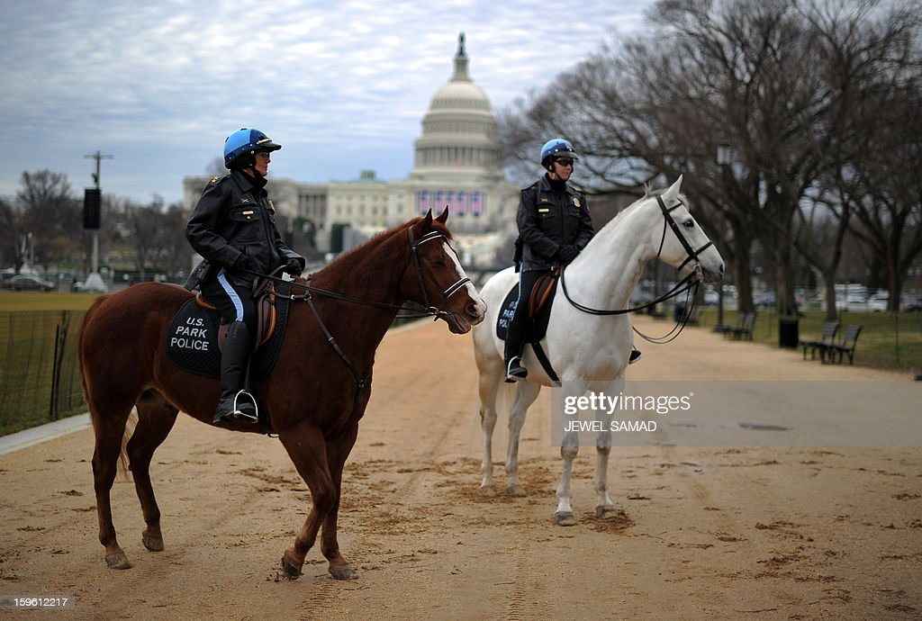 Two horse-mounted US park policewomen patrol along the Mall as preparations continue for the second inauguration of US President Barack Obama in Washington, DC, on January 17, 2013. Obama faces a near impossible task in his second inaugural address on January 21, uniting a nation in which the compromise that oils governing is crushed by deep political divides. Before a crowd of thousands and the eyes of the world on television and online, Obama will stand on the West Front of the US Capitol and swear to faithfully execute the office of president and defend the Constitution. AFP PHOTO/Jewel Samad