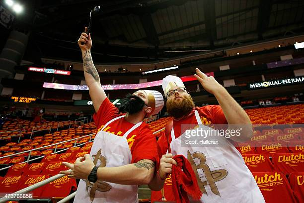 Two Houston Rockets fans prepare for Game Seven of the Western Conference Semifinals against the Los Angeles Clippers at the Toyota Center for the...