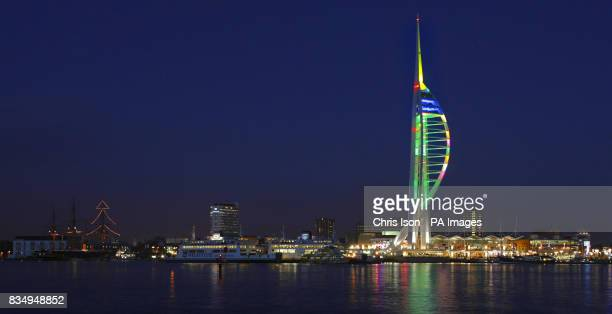Two huge Christmas 'trees' light up Portsmouth Harbour in Hampshire as the lights of the Spinnaker Tower have been reset to give it a green trunk and...