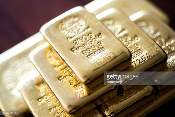 Two hundred and fifty gram gold bars sit stacked in this arranged photograph at Solar Capital Gold Zrt in Budapest Hungary on Thursday March 10 2016...