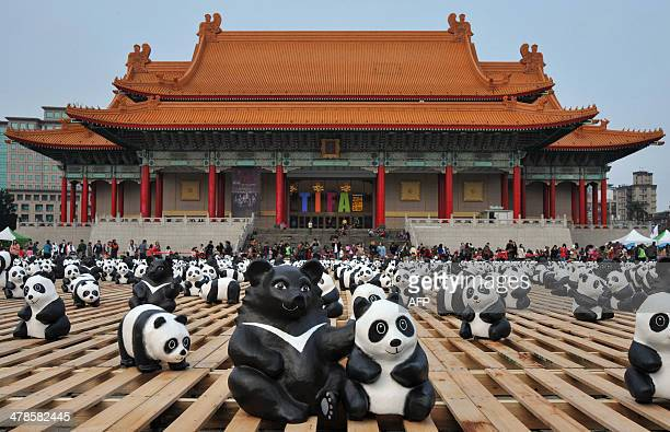Two hundred paper Formosan Black Bears are surrounded by paper pandas at an exhibition called 'Pandas on Tour' at the Liberty Square of National...