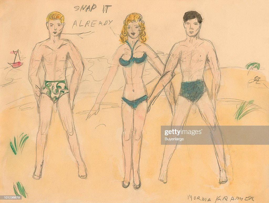 Two hunky men in tight swim trunks stand next to a bikini clad female on the beach.